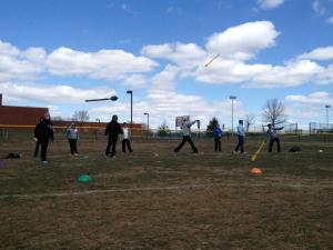 Coaches learning to throw the mini javelin at the Athletic Field Events Clinic last weekend.