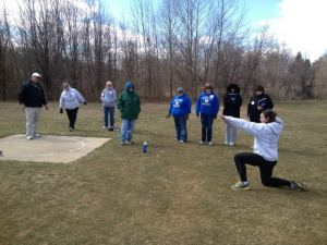 Coaches learned shot put at the Athletic Field Events Clinic last weekend.